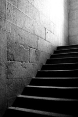 From dark to light. Medieval Spanish castle stone stairs.