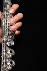 Flute in hands - music background. Classic music concert concept