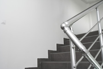 Modern metal staircase bars in an office building