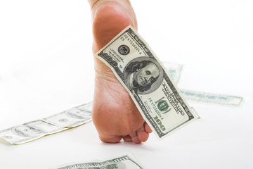 American dollars under foot. Business and easy money concept