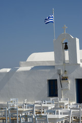 restaurant taverna by classic greek island church   greece