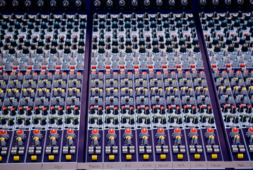 Color buttons and controls on audio mixing console