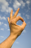 Human hand showing sign of OK, all right, good, excelent. poster