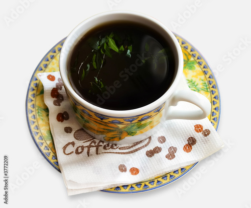 Cup of coffee, reflection of a flower, White background