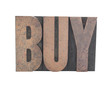 the word 'BUY' in old wood letters