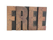the word 'Free' in old, inkstained wood letterpress type