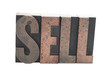 the word 'SELL' in old wood letters