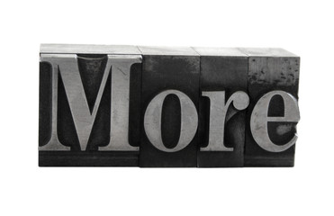 the word 'More' in old, inkstained metal type