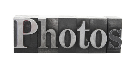 the word 'photos' in old, inkstained metal type