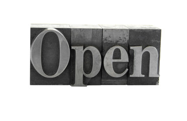 the word 'Open' in old, inkstained metal type