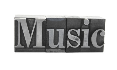the word 'Music' in old, inkstained metal type