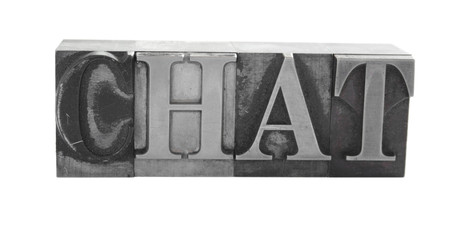 the word 'CHAT' in old, inkstained metal type