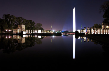 WW II Memorial night with Washington Monument  and refelection