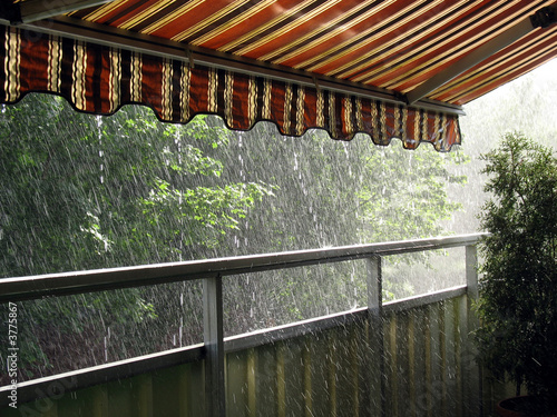 Heavy rain in the summer time under an awning