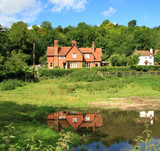 English Rural Houses with a pond in the foreground poster