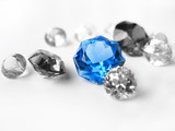 Blue gemstone among colorless gemstones