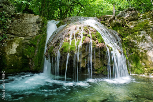 The beautiful waterfall in forest, spring,  long exposure - 3781840