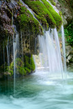 Fototapety The beautiful waterfall in forest, spring,  long exposure