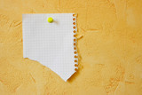 Lacerated blank sheet attached to a yellow wall poster