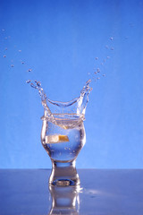 A glass with a drink splashing about 4