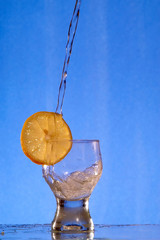 A glass with a drink splashing about 2