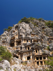 Ancient tombs on rocks in antique Myra town, Turkey