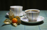 Two cups on a green wooden napkin poster