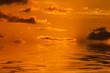 beautiful orange sky reflected in the water