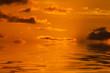 beautiful orange sky reflected in the water