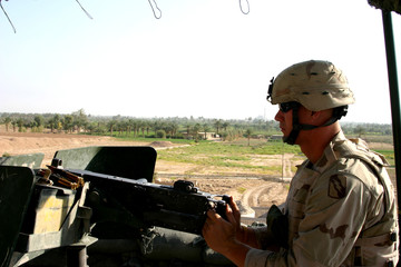 Amercian Soldier at an Outpost in Iraq