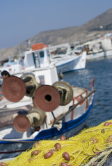 fishing boats greek islands cyclades selective focus  on nets