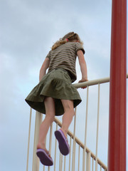 girl climbing over railing