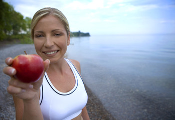 healthy athlete holding red apple