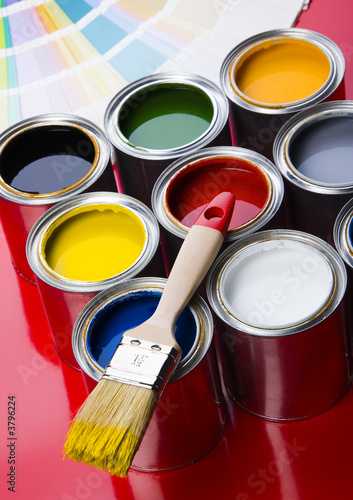 colorful cans and brush