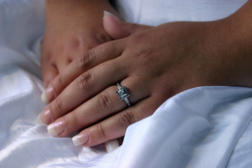 closeup of a bride's hands and engagement ring