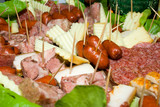Sausage, slices of salami, bacon, ham and cheese on toothpicks poster