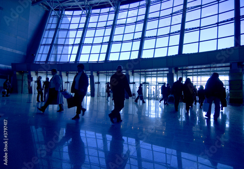 People silhouettes at airport building