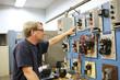 teacher working on an industrial motor control center