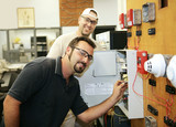 Electricians learning to repair fire alarm systems  poster