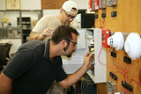 Electricians learning how to wire fire alarm systems  poster