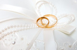 Wedding rings on a white pillow. poster