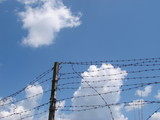 Cloudy blue sky with rugged wire fence 3 poster