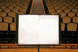 music stand with empty white paper poster