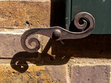 Old cast iron window door catch, Spitalfields, London UK poster