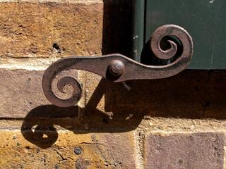 Old cast iron window door catch, Spitalfields, London UK