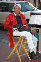 Christmas musician playing on the streets during the holidays.