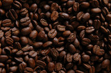 A close up shot of fresh whole coffee beans poster