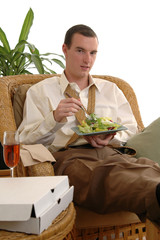 A man eating a take out meal at home