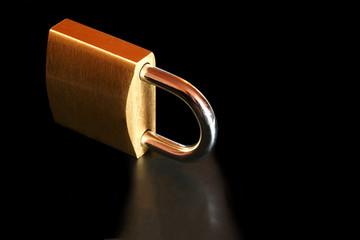 Brass Padlock, reflected on black.