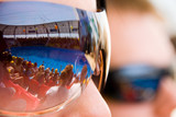 Spectators with mirrored sun-glasses poster